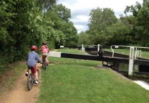 Cycling past the Kennet and Avon canal locks