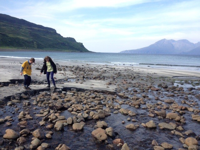 Crossing the stones on Laig beach, Eigg