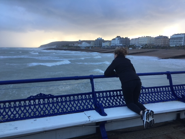 Watching the rain approach from Eastbourne pier