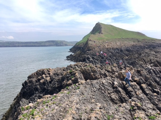 Crossing the jagged rocks on Worm's Head