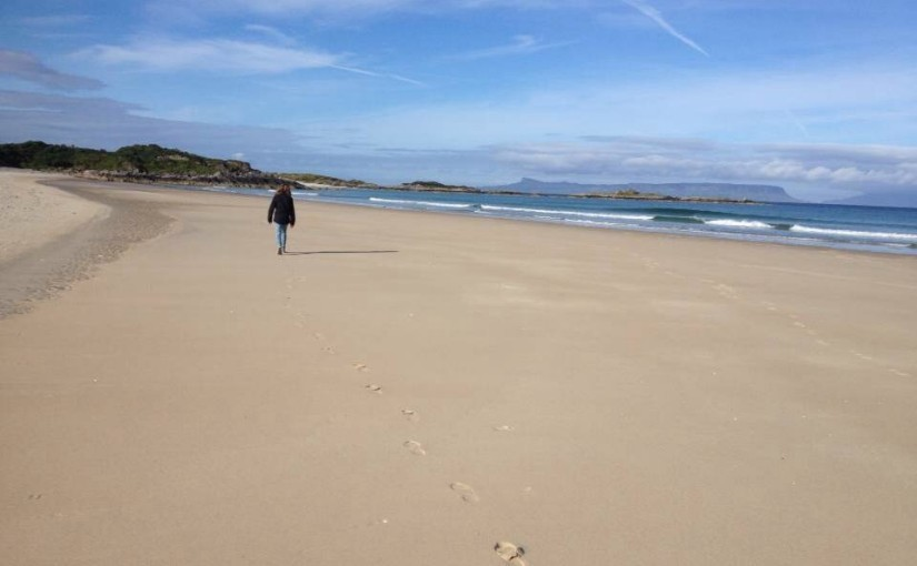 Camusdarach beach with Isle of Eigg in background