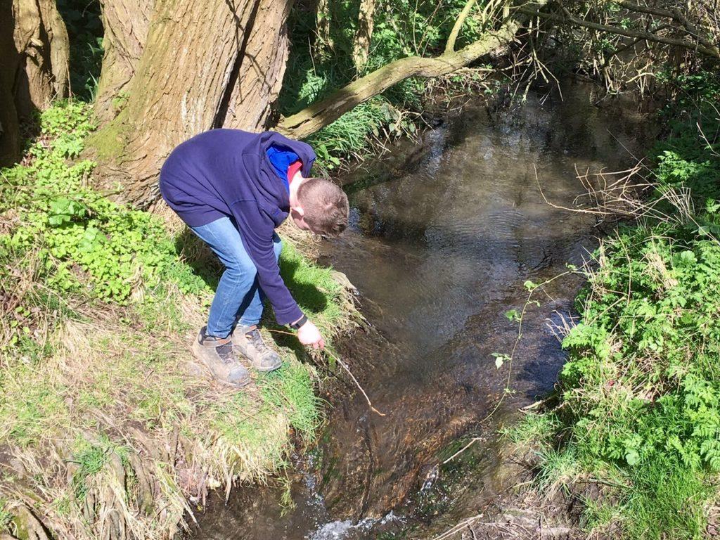 A boy, a stick and a stream!