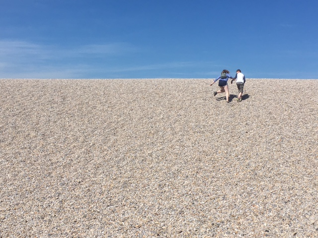 Running up the shingle on Chesil Beach