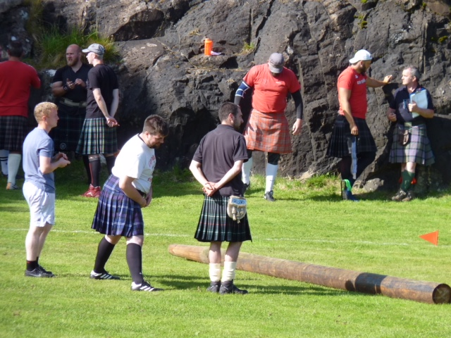 Tossing the caber (or considering it) at the Skye Highland Games